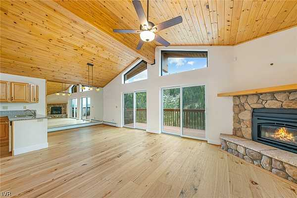 Photo #3 Entry Level Open Great Room with new Hickory Hardw