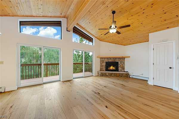 Photo #4 Entry Level Open Great Room with new Hickory Hardw