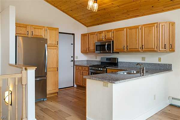 Photo #6 Updated Kitchen with Stainless Steel Appliances.
